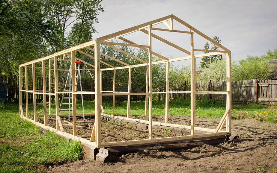build a greenhouse or buy a greenhouse